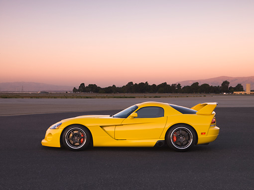 VIP 01 RK0260 01 © Kimball Stock 2006 Hennessey Venom 800R Yellow Profile View On Pavement