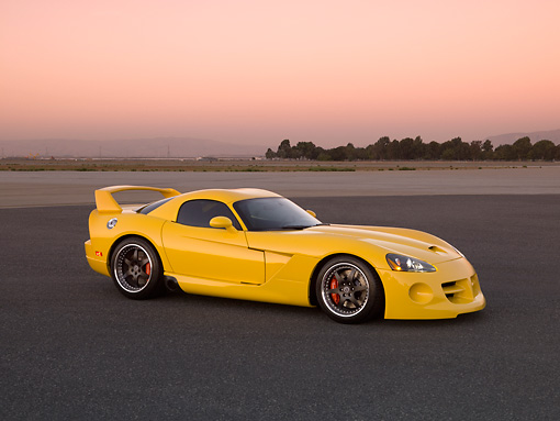 VIP 01 RK0263 01 © Kimball Stock 2006 Hennessey Venom 800R Yellow 3/4 Side View On Pavement