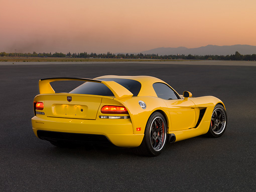 VIP 01 RK0264 01 © Kimball Stock 2006 Hennessey Venom 800R Yellow 3/4 Rear View On Pavement