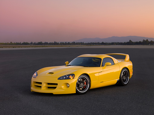 VIP 01 RK0265 01 © Kimball Stock 2006 Hennessey Venom 800R Yellow 3/4 Side View On Pavement