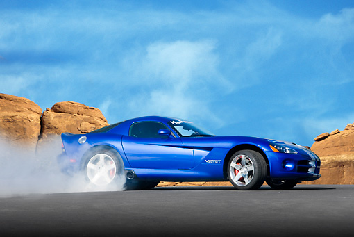 VIP 01 RK0302 01 © Kimball Stock 2010 Dodge Viper SRT-10 Blue Burning Tires On Pavement