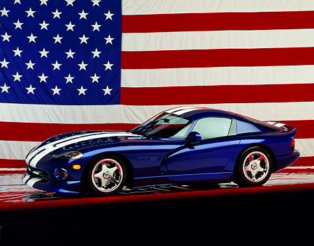 VIP 02 RK0029 05 © Kimball Stock Dodge Viper GTS Concept Car Blue White Stripe 3/4 Side View On Red Line American Flag Studio