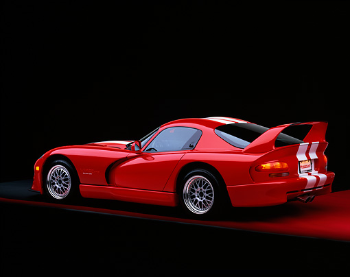 VIP 02 RK0060 02 © Kimball Stock 1997 Dodge Hennessey Viper Venom 600 GTS Red White Stripes 3/4 Rear View On Red Floor Studio