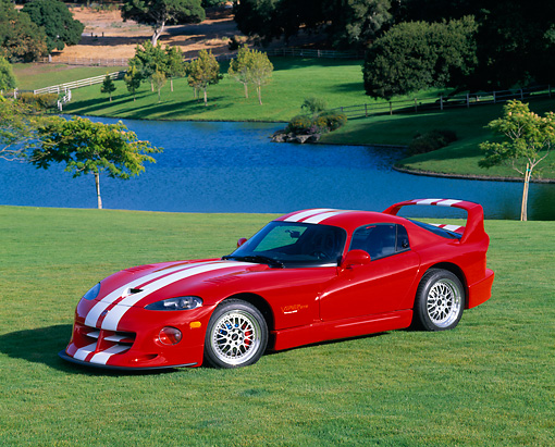 VIP 02 RK0076 06 © Kimball Stock 1997 Dodge Hennessey Viper Venom 600 GTS Red White Stripes 3/4 Side View On Grass By Water