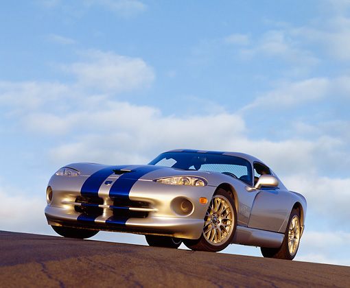 VIP 02 RK0101 06 © Kimball Stock 1999 Dodge Viper GTS ACR Silver Blue Stripe Low 3/4 Front View On Pavement Hill Blue Sky