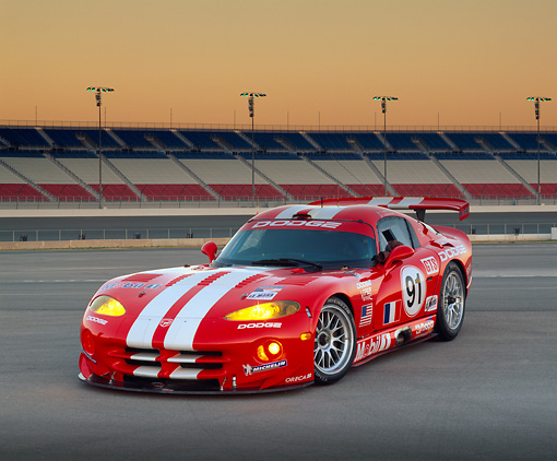 VIP 02 RK0104 04 © Kimball Stock 1999 Dodge Viper GTS R Lemans Racing Car Red And White Stripe 3/4 Front View On Race Track