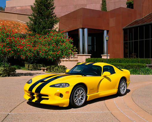 VIP 02 RK0162 03 © Kimball Stock 2001 Viper GTS ACR Yellow Black Stripe 3/4 Front View On Pavement By Trees And Building