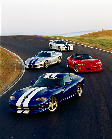 VIP 03 RK0039 05 © Kimball Stock Four Dodge Vipers Parked On Race Track Parking Lights On At Dusk