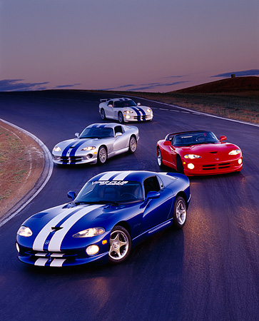 VIP 03 RK0040 01 © Kimball Stock Four Dodge Vipers On Race Track At Dusk