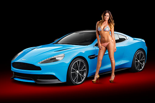 WMN 03 BK0001 01 © Kimball Stock 2013 Aston Martin Vanquish Blue 3/4 Front View In Studio With Swimsuit Model
