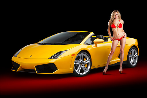 WMN 03 BK0002 01 © Kimball Stock 2012 Lamborghini Gallardo LP 550-2 Spyder  Yellow 3/4 Front View In Studio With Swimsuit Model