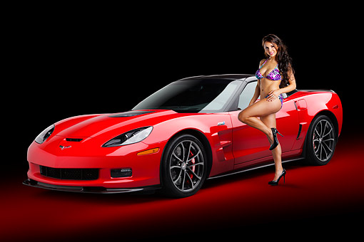 WMN 03 BK0003 01 © Kimball Stock 2013 Chevrolet Corvette ZR1 Red 3/4 Front View In Studio With Swimsuit Model