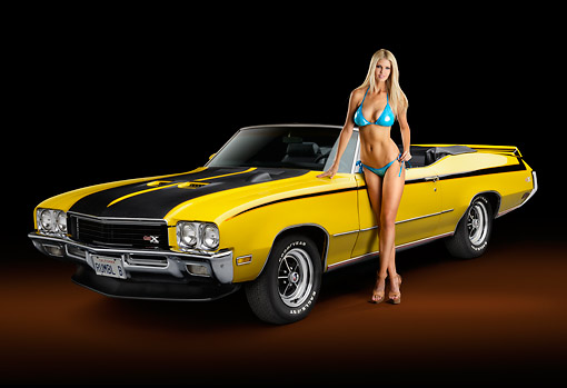 WMN 03 RK0309 01 © Kimball Stock 1971 Buick GSX Yellow With Black Stripes 3/4 Front View In Studio With Swimsuit Model