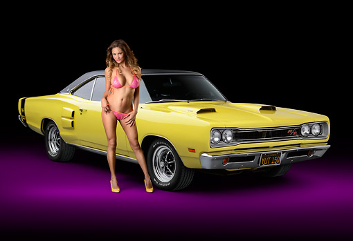 WMN 03 RK0310 01 © Kimball Stock 1969 Dodge Coronet R/T Yellow 3/4 Front View In Studio With Swimsuit Model