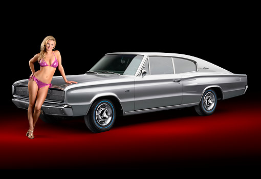 WMN 03 RK0315 01 © Kimball Stock 1966 Dodge Hemi Charger Silver Gray 3/4 Front View In Studio With Swimsuit Model
