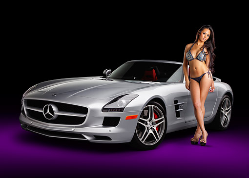 WMN 03 RK0318 01 © Kimball Stock 2012 Mercedes-Benz SLS Silver 3/4 Front View In Studio With Swimsuit Model