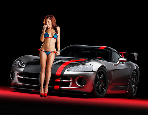 WMN 03 RK0324 01 © Kimball Stock Dodge Viper SRT-10 Mopar Gray And Black Low 3/4 Front View In Studio With Swimsuit Model