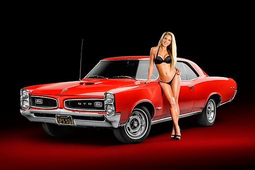 WMN 03 RK0332 01 © Kimball Stock 1966 Pontiac GTO Red 3/4 View In Studio With Swimsuit Model