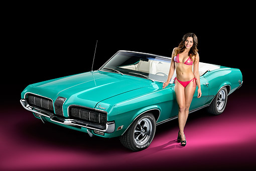 WMN 03 RK0333 01 © Kimball Stock 1970 Mercury Cougar Green 3/4 View In Studio With Swimsuit Model