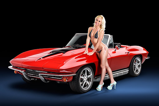 WMN 03 RK0349 01 © Kimball Stock 1967 Chevrolet Corvette Convertible Red 3/4 Front View In Studio With Swimsuit Model