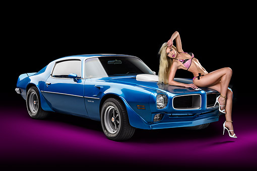 WMN 03 RK0352 01 © Kimball Stock 1970 1/2 Pontiac Trans Am Blue 3/4 Front View In Studio With Swimsuit Model
