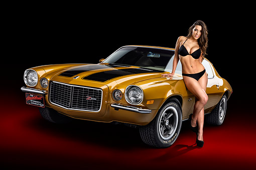 WMN 03 RK0354 01 © Kimball Stock 1970 1/2 Chevrolet Camaro Z28 Gold 3/4 Front View In Studio With Swimsuit Model