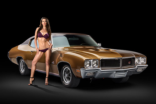WMN 03 RK0357 01 © Kimball Stock 1970 Buick GS Stage 1 Gold 3/4 Front View In Studio With Swimsuit Model