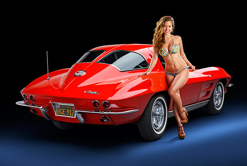 WMN 03 RK0361 01 © Kimball Stock 1963 Chevrolet Corvette Sting Ray Split-Window Coupe Red 3/4 Rear View With Model In Studio