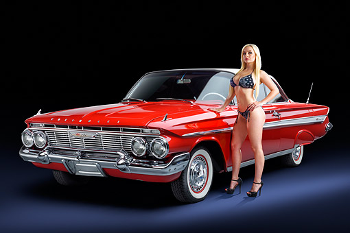 WMN 03 RK0367 01 © Kimball Stock 1961 Chevrolet Impala Red 3/4 Front View With Model In Studio