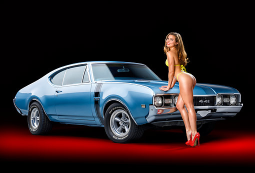 WMN 03 RK0368 01 © Kimball Stock 1968 Oldsmobile 442 Blue 3/4 Front View With Model In Studio