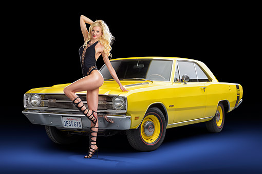 WMN 03 RK0396 01 © Kimball Stock 1969 Dodge Dart GTS 383 Sunfire Yellow 3/4 Front View In Studio With Model