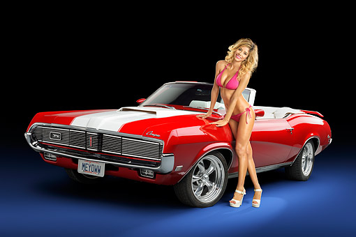 WMN 03 RK0398 01 © Kimball Stock 1969 Mercury Cougar XR-7 Convertible Red And White 3/4 Front View In Studio With Model