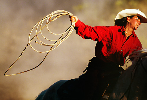 WRG 01 RK0231 09 © Kimball Stock Close-Up Of Wrangler Riding On Horse Holding Rope